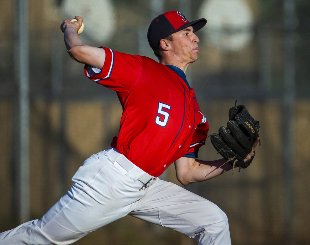 Liberty' pitcher Garrett Maloney (5) finishes off Spring Valley during the first round of the D ...