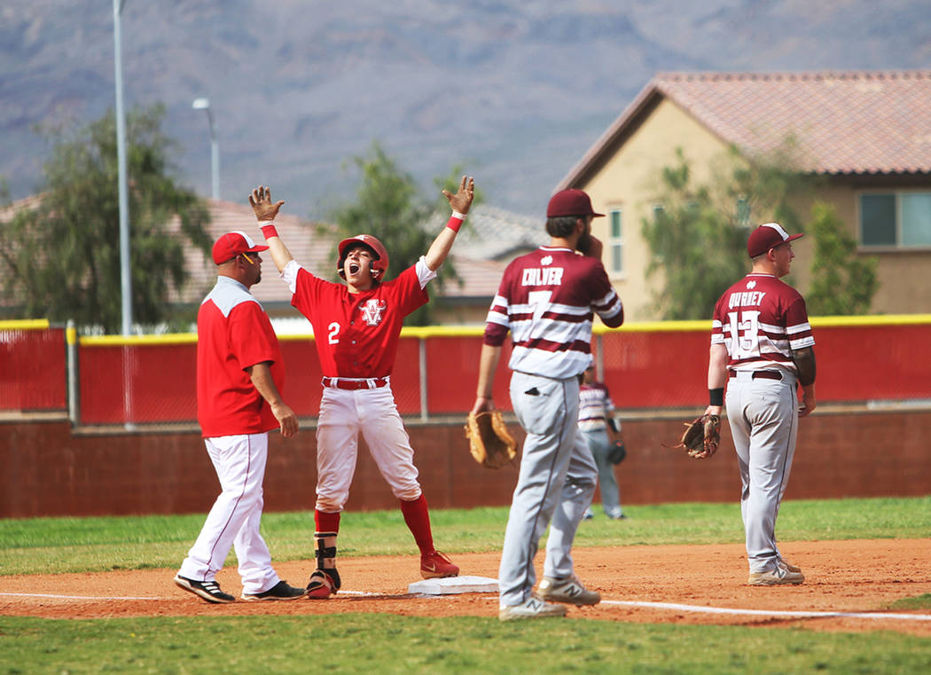 Arbor View's Nicholas Cornman (2) cheers after making it safe to third base in the second round ...