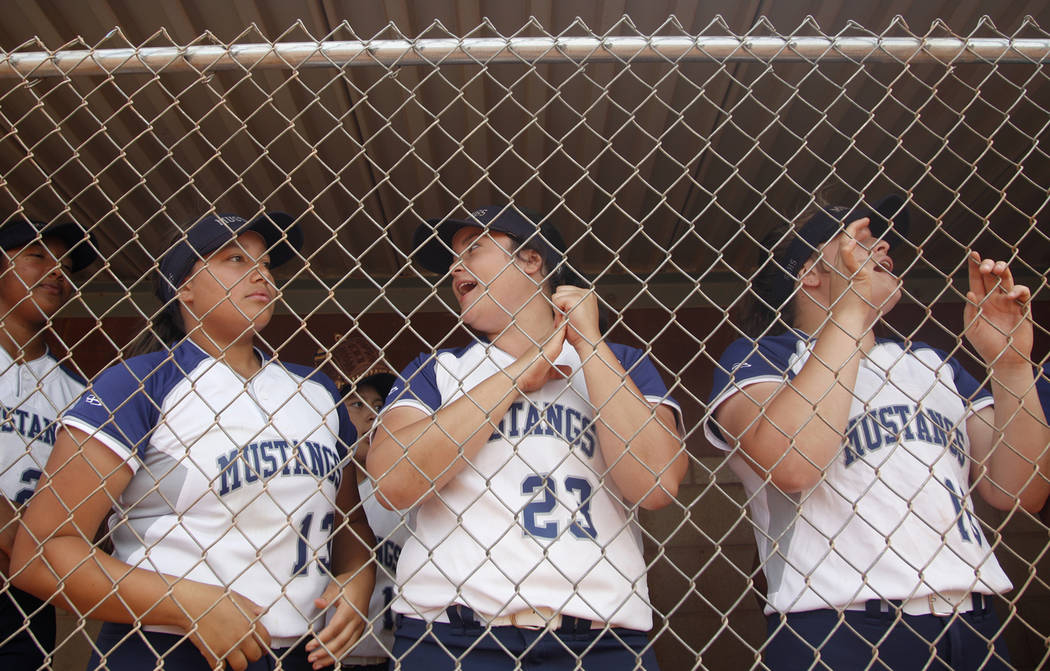 Shadow Ridge High School players Mikayla Brown (13), Alexis Toia (23), and Tori Nichols (16) ch ...
