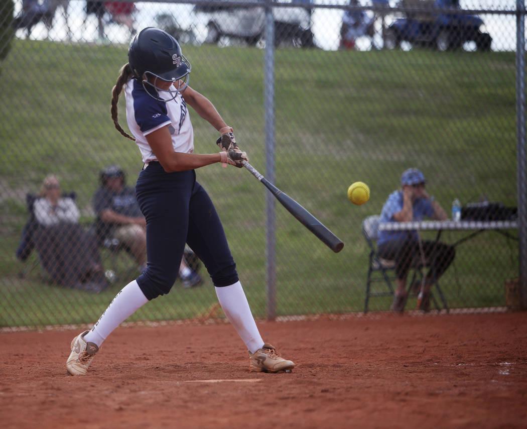 Shadow Ridge High School's Taylor Hendricks (5) bats against Centennial High School in the moun ...
