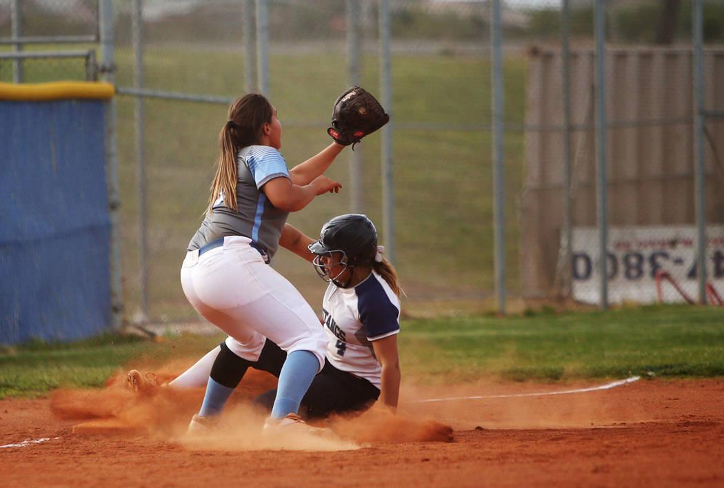 Centennial High School's Sofia Ruelas (10) fails to tag out Shadow Ridge High School's Shea Cle ...