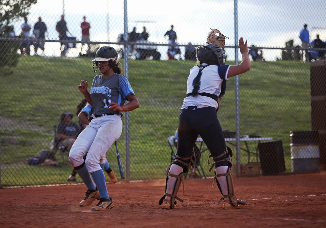 Centennial High School's Jacqueline Perez Mena (11) makes home base against Shadow Ridge High S ...