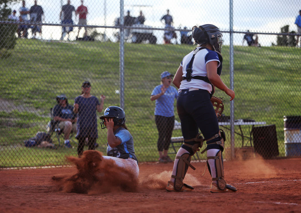 Centennial High School's Natasha Lawrence (3) makes a home run right after another teammate, ev ...