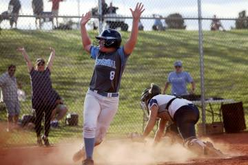 Centennial High School's Ashlynn Heck (8) makes a home run, winning the game 3-2 against Shadow ...