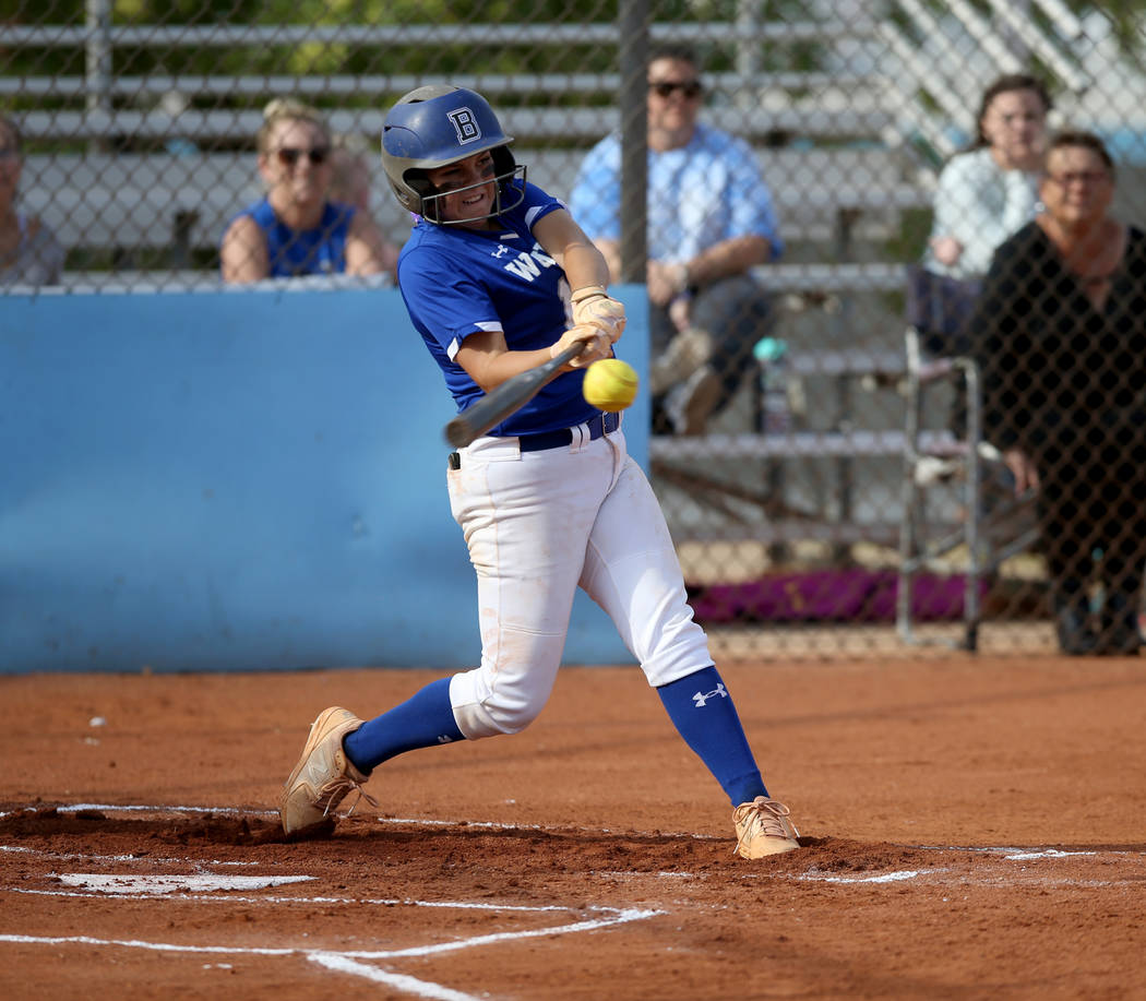 Basic's Mikayla Berg (15) hits a three-run single in the first inning of their Desert Region se ...