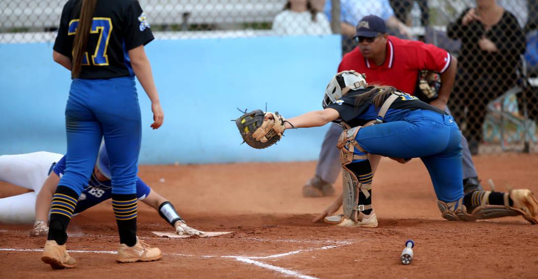 Basic's Jordan Stinett (10) slides across home plate as Sierra Vista catcher Aaliyah Medina (1 ...