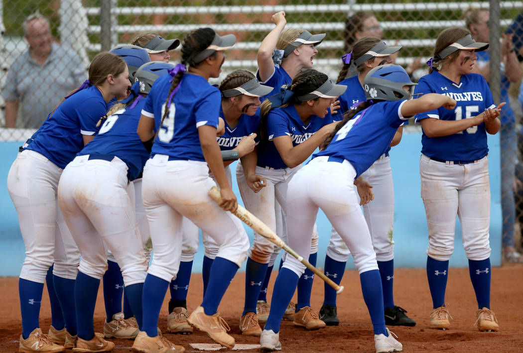 Basic players celebrate a home run by Sierra McClean (12) in the fourth inning of their Desert ...