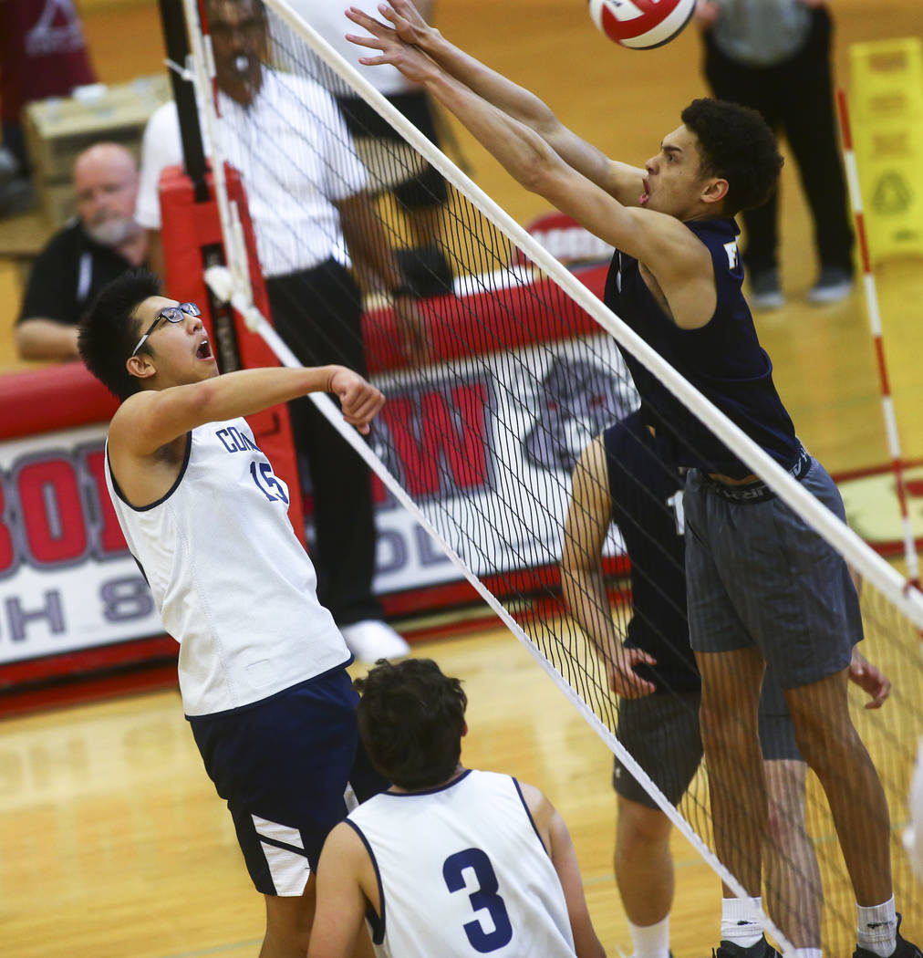 Coronado's Justin Fan (15) gets the ball past Foothill's Jace Roquemore (3) during the Desert R ...