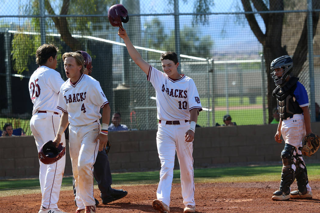 Desert Oasis' Colby Smith (10) reacts at home plate after hitting a two run home against Basic ...