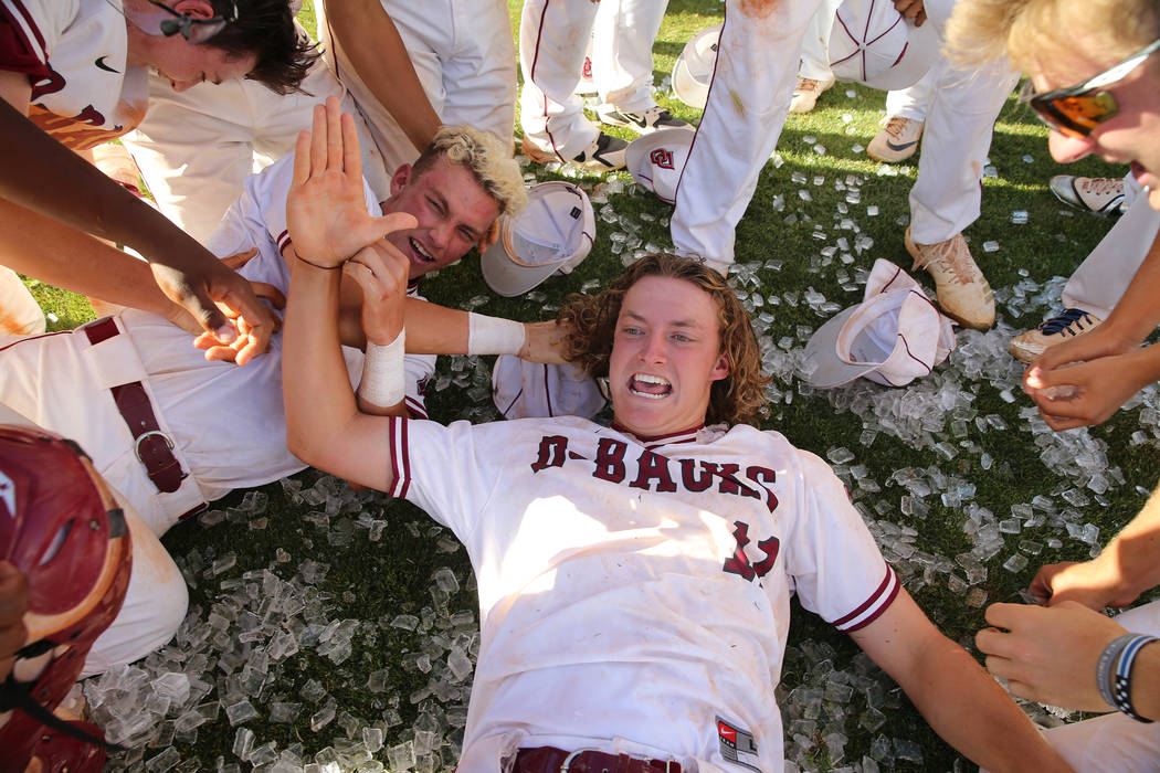 Desert Oasis' pitcher Josh Sharman (11) celebrates a win with his team over Basic in the Desert ...