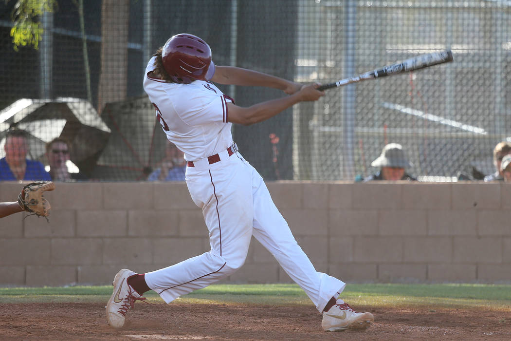 Desert Oasis' Campbell Holt (16) his a two run homer against Basic in the Desert Region champio ...
