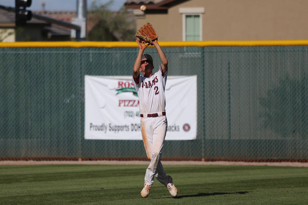 Desert Oasis' Jordan DeMarce (2) makes a catch for an out in the outfield against Basic in the ...