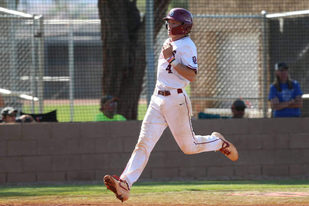 Desert Oasis' Parker Schmidt (4) runs home for a run against Basic in the Desert Region champio ...