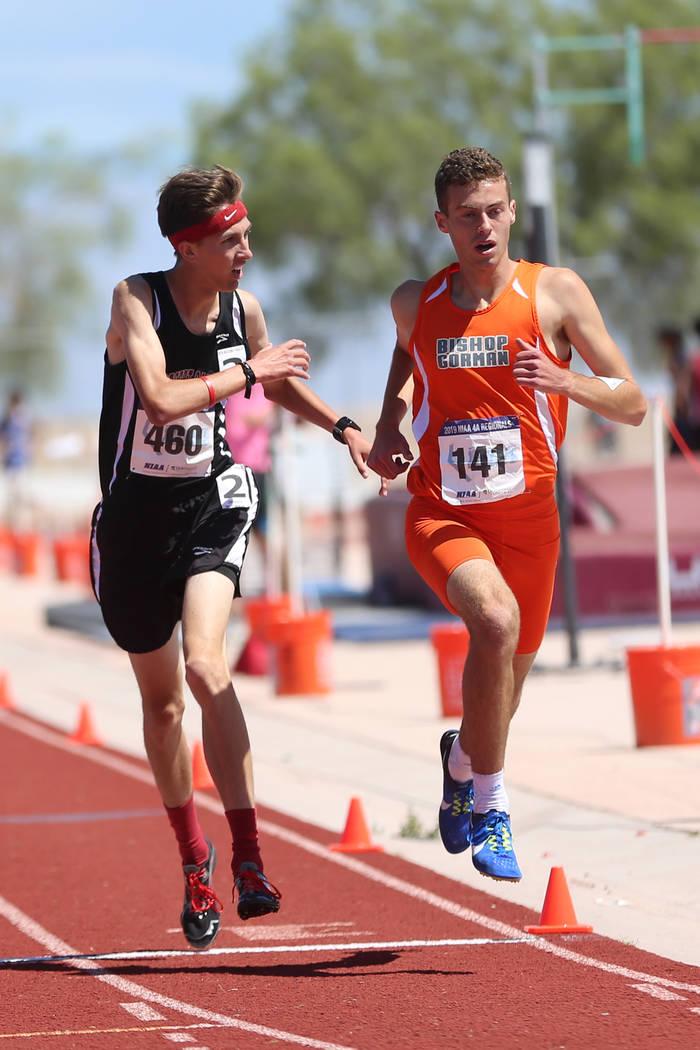 Bishop Gorman's Massimiliano Swenson (141), right wins the Desert Region boys 3200 meter run, f ...