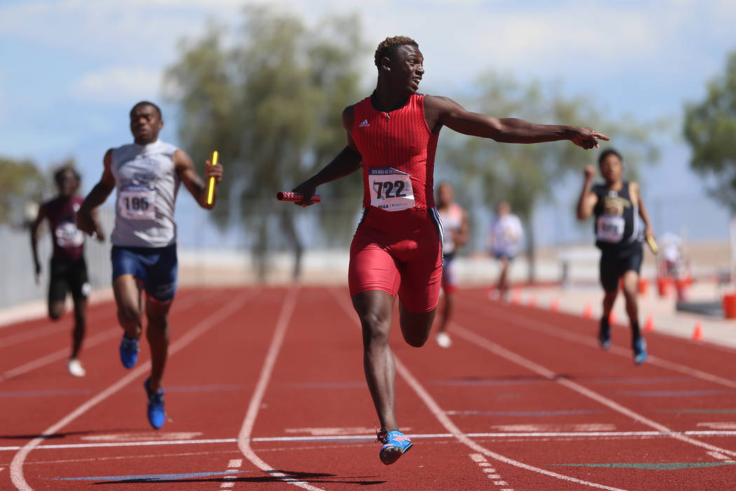 Las Vegas' Miles Davis (722) runs for first place in the Mountain Region boys 4x200 meter relay ...