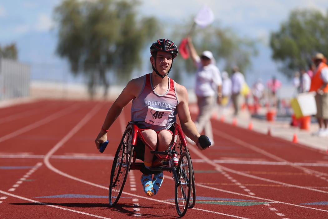 Arbor View's Blake Dickinson (46) competes in the Mountain Region boys 100 meter wheelchair das ...