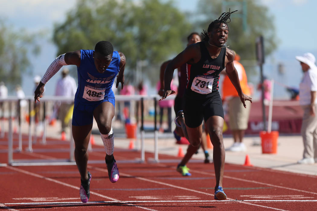 Desert Pines' Jamel Brown (482), left, wins first place in the Mountain Region boys 110 meter h ...