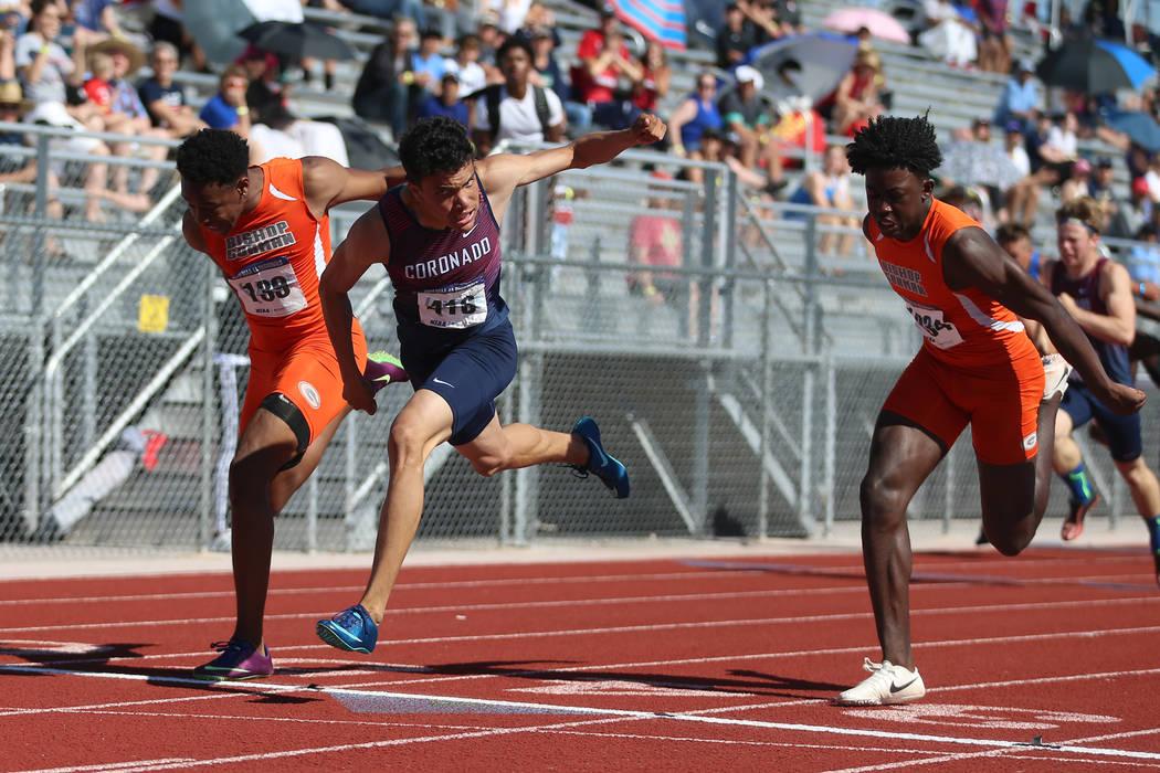 Coronado's Justin Watterson (419), center, runs for first place in the Desert Region boys 110 m ...
