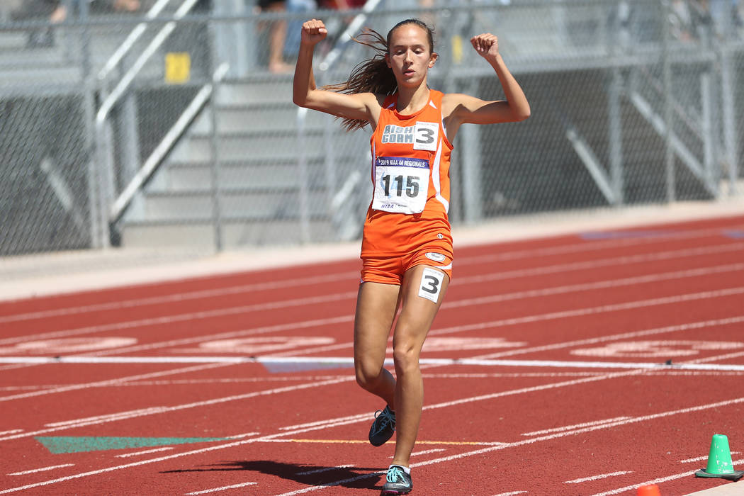 Bishop Gorman's Emilia Puskas (115) runs for first place in the Desert Regions girls 3200 meter ...