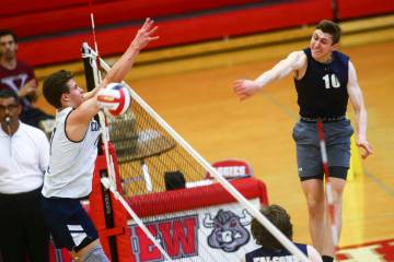 Foothill's Caleb Stearman (10) spikes the ball past Coronado's Jacob Ceci (7) during the Desert ...