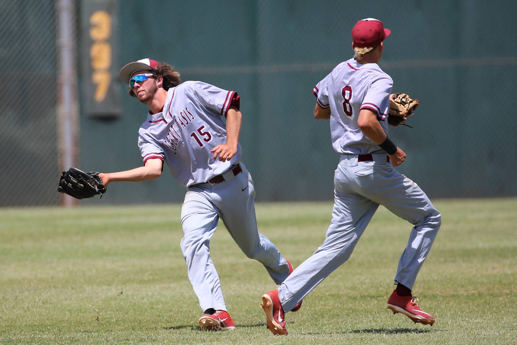Desert Oasis' Campbell Holt (15) makes a catch in the outfield for an out against Las Vegas as ...