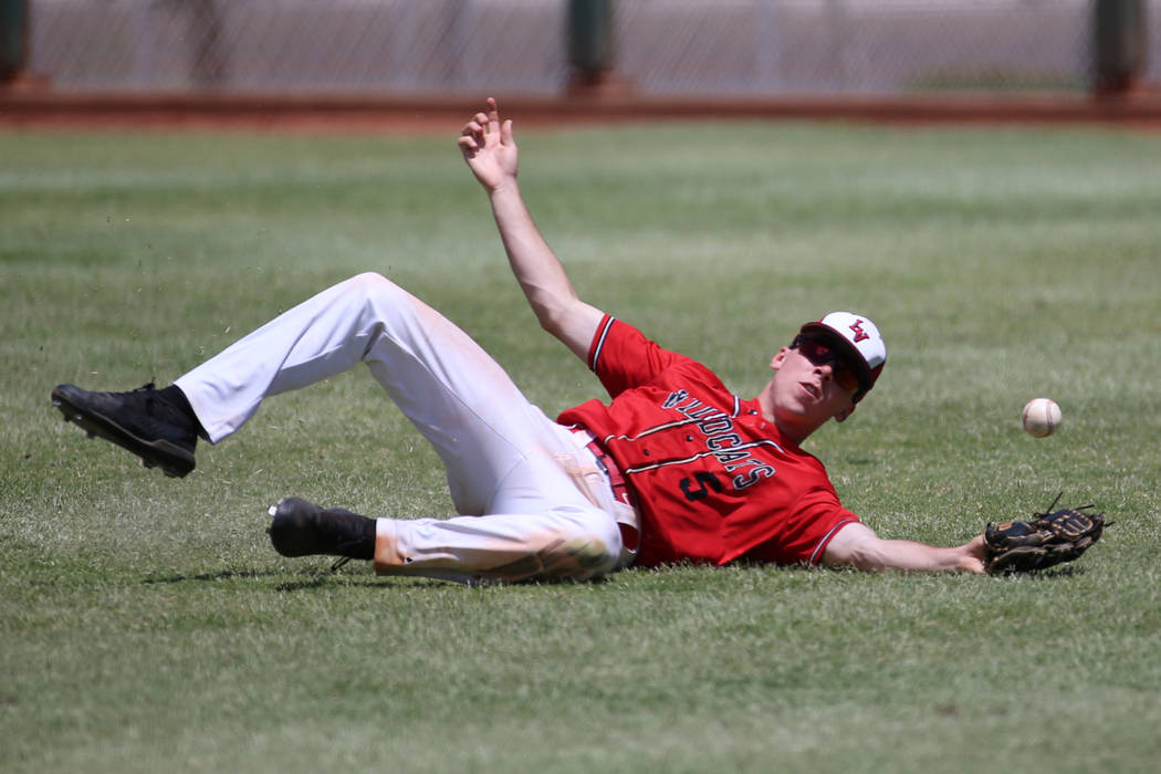 Las Vegas' Joel Lindahl (5) misses the ball in the outfield against Desert Oasis in the Souther ...