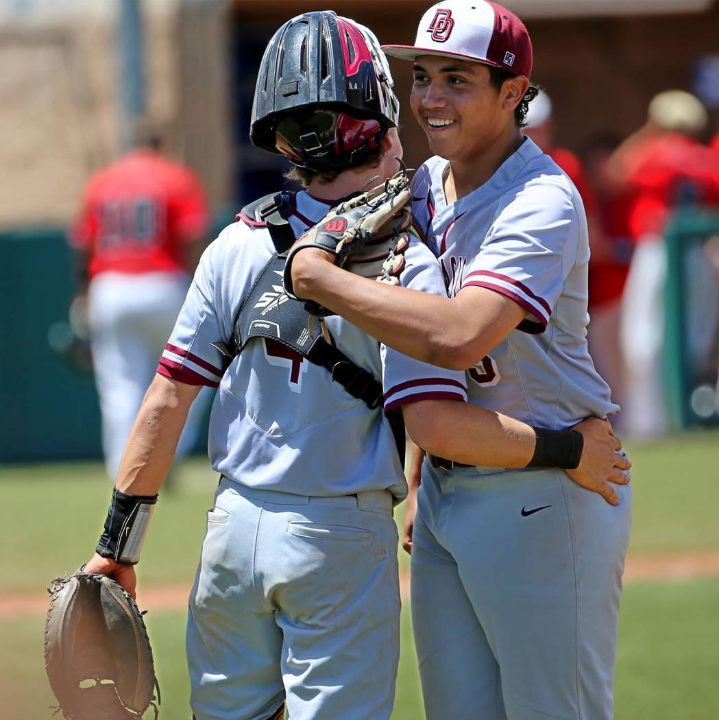 Desert Oasis' pitcher Aaron Roberts (25), right, embraces catcher Parker Schmidt (4) after str ...