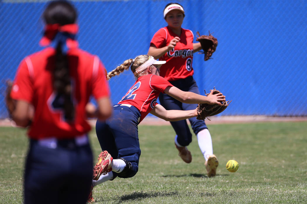 Coronado's Paige Sinicki (12) misses the ball in the outfield as her teammate Madison Stephens ...