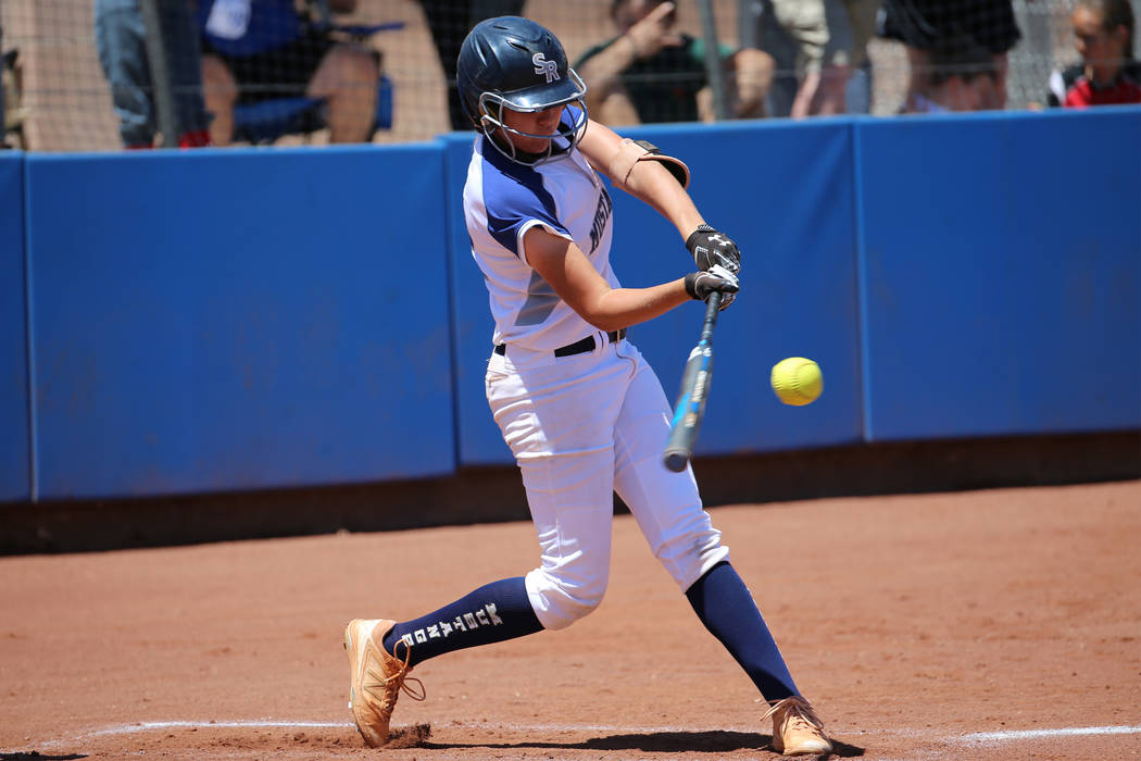 Shadow Ridge's Hailey Morrow (12) hits the ball for a solo homer against Coronado in the Southe ...