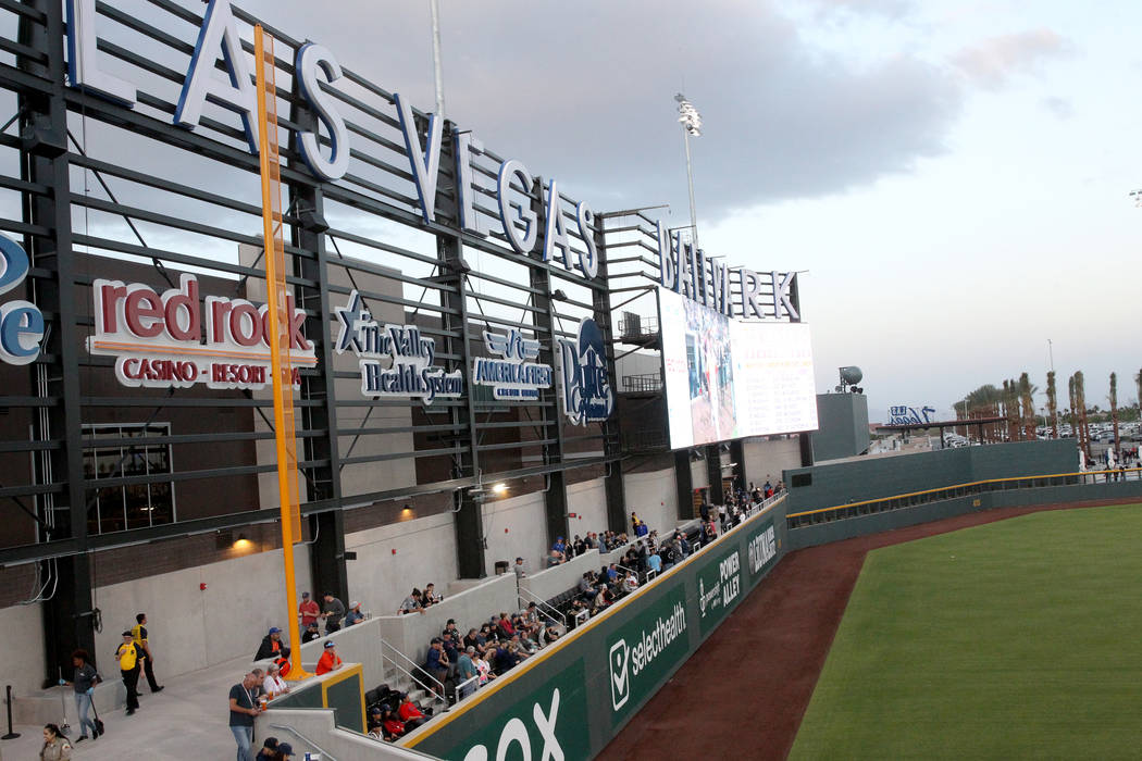 Fans watch the action from the left field wall on the first-ever opening night for the Las Vega ...