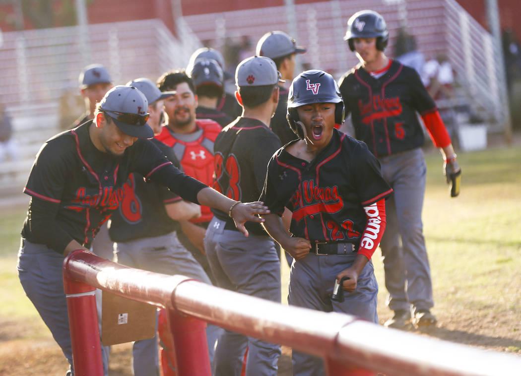 Las Vegas' Layne Adaro (22) celebrates his run against Arbor View during a baseball game at Arb ...