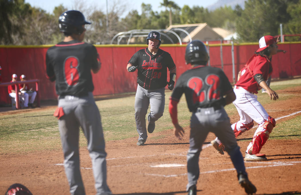 Las Vegas' first baseman Trevor Johnson (20) scores a run during a baseball game at Arbor View ...