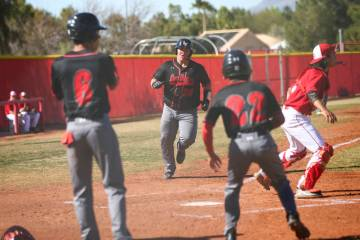 Las Vegas' first baseman Trevor Johnson (20) scores a run during a baseball game at Arbor View ...