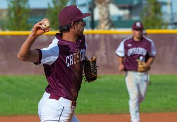 Faith Lutheran's Michael Rice (2) looks to first base on a throw versus Palo Verde during their ...