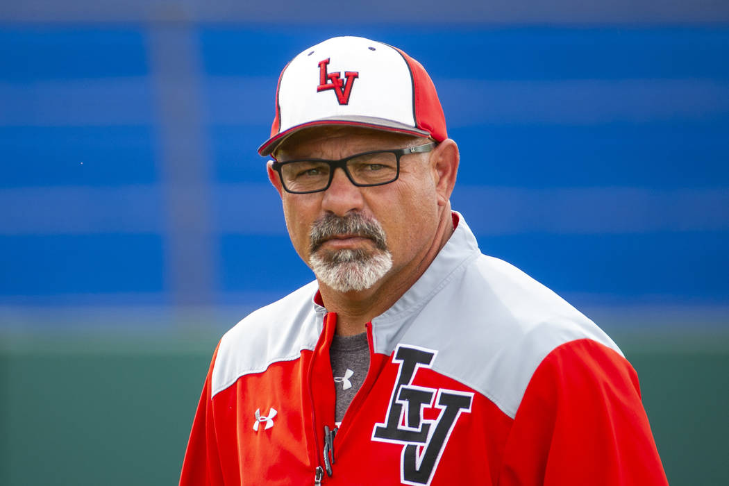 Longtime Las Vegas High coach Sam Thomas eyes his players during their state baseball tournamen ...