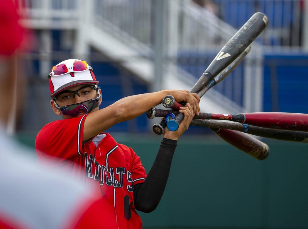 Las Vegas' Oliver Reyes (6) warms up to bat versus Reno during their state baseball tournament ...