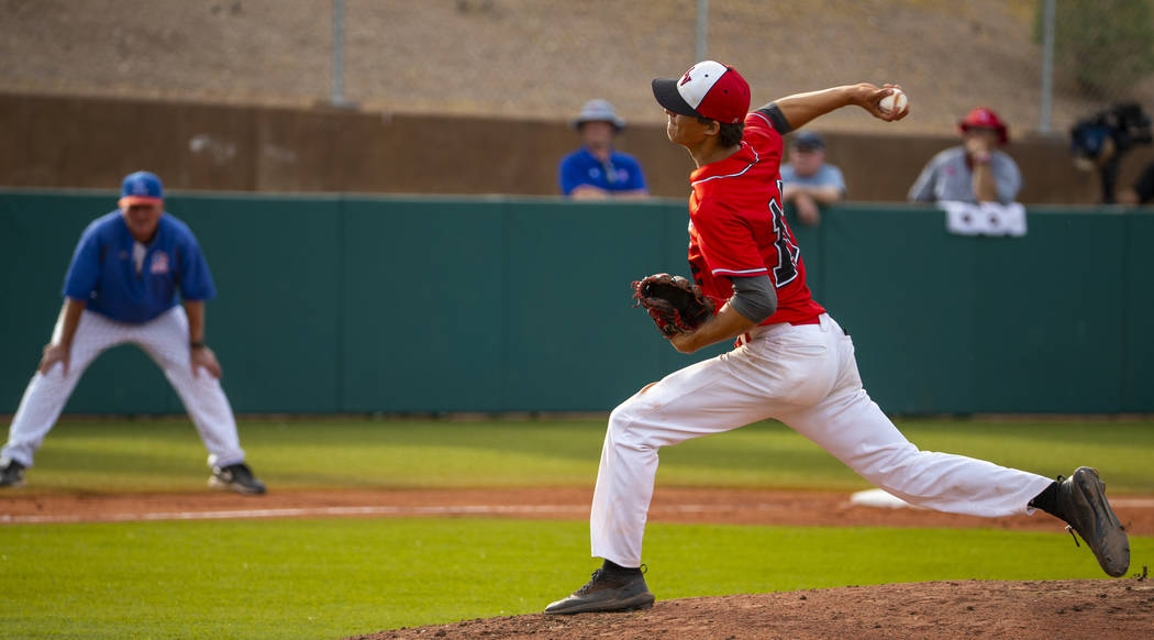 Las Vegas pitcher Nathan Freimuth (12) winds up for a throw versus Reno during their state base ...