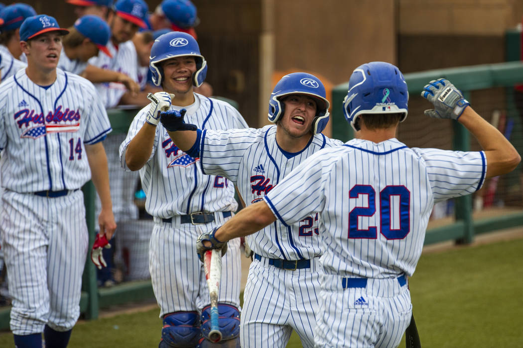 Reno players celebrate a score by teammate Coleman Schmidt (20) versus Las Vegas during their s ...