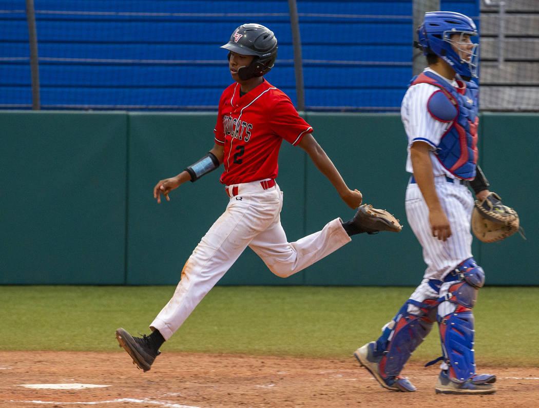 Las Vegas' Martin Simmons (2) scores past Reno's Lane Oliphant (28) during their state baseball ...