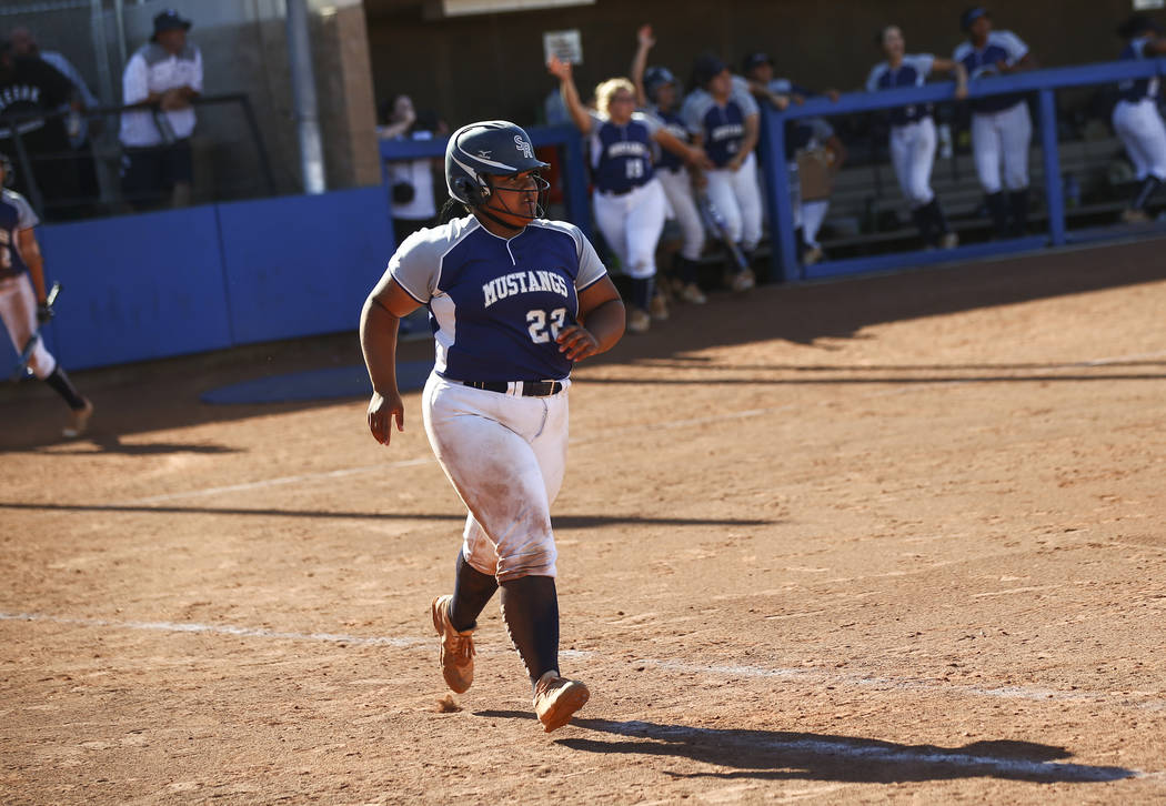 Shadow Ridge's Alyssa Stanley (22) rounds the bases on her home run hit against McQueen during ...