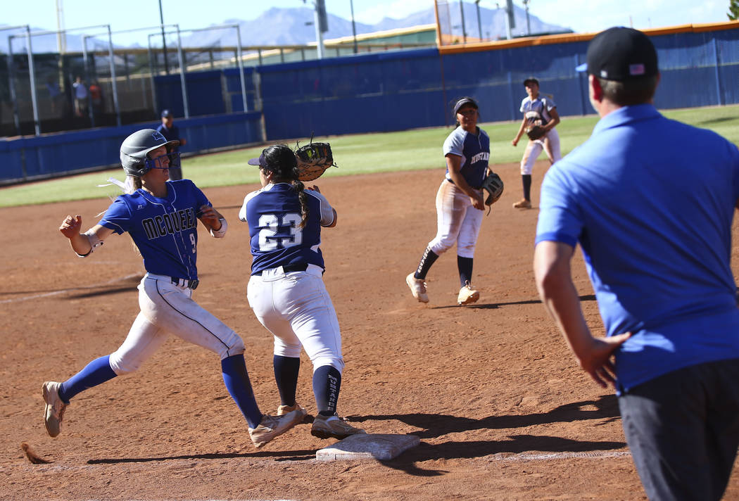 McQueen's Rylie Miller (9) gets tagged out by Shadow Ridge's Alexis Toia (23) during the second ...