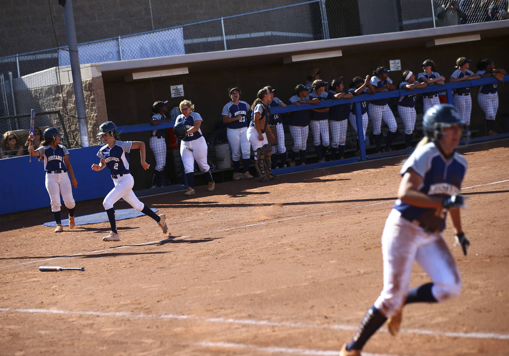 Shadow Ridge's Jasmine Payne (2) heads to home plate to score a run against McQueen during the ...
