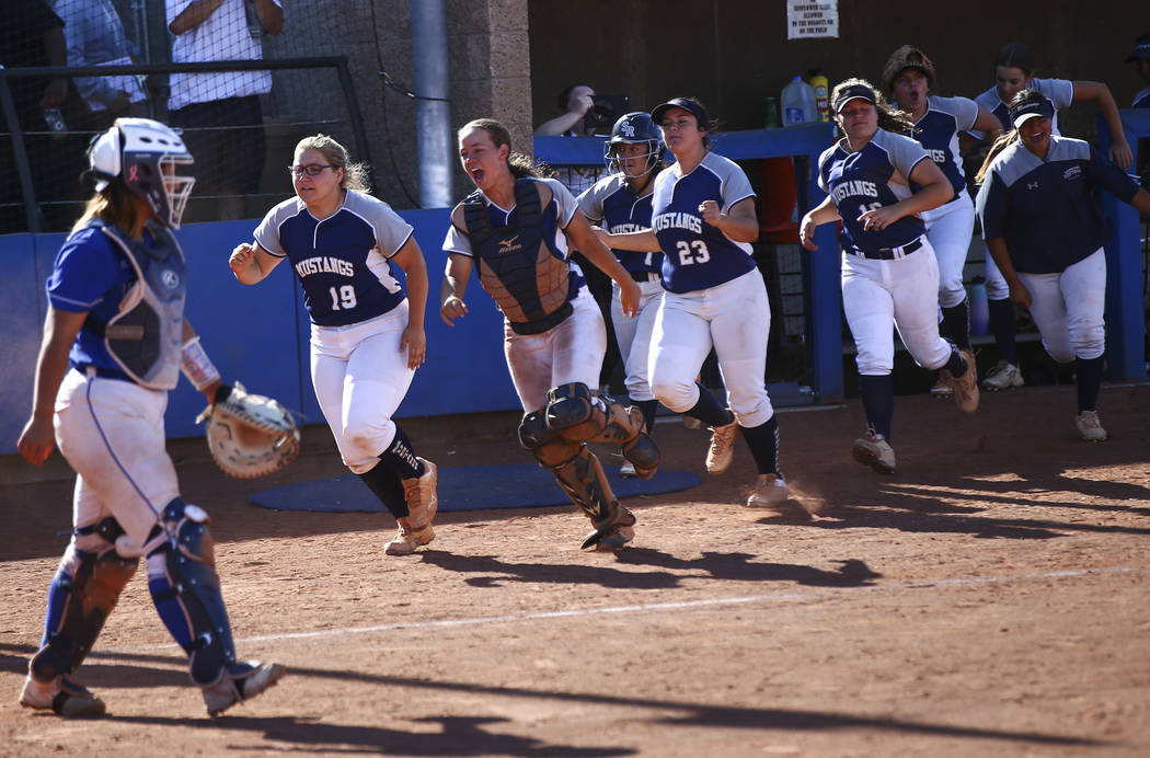 Shadow Ridge players celebrate a run by Alyssa Stanley, not pictured, during the second round o ...