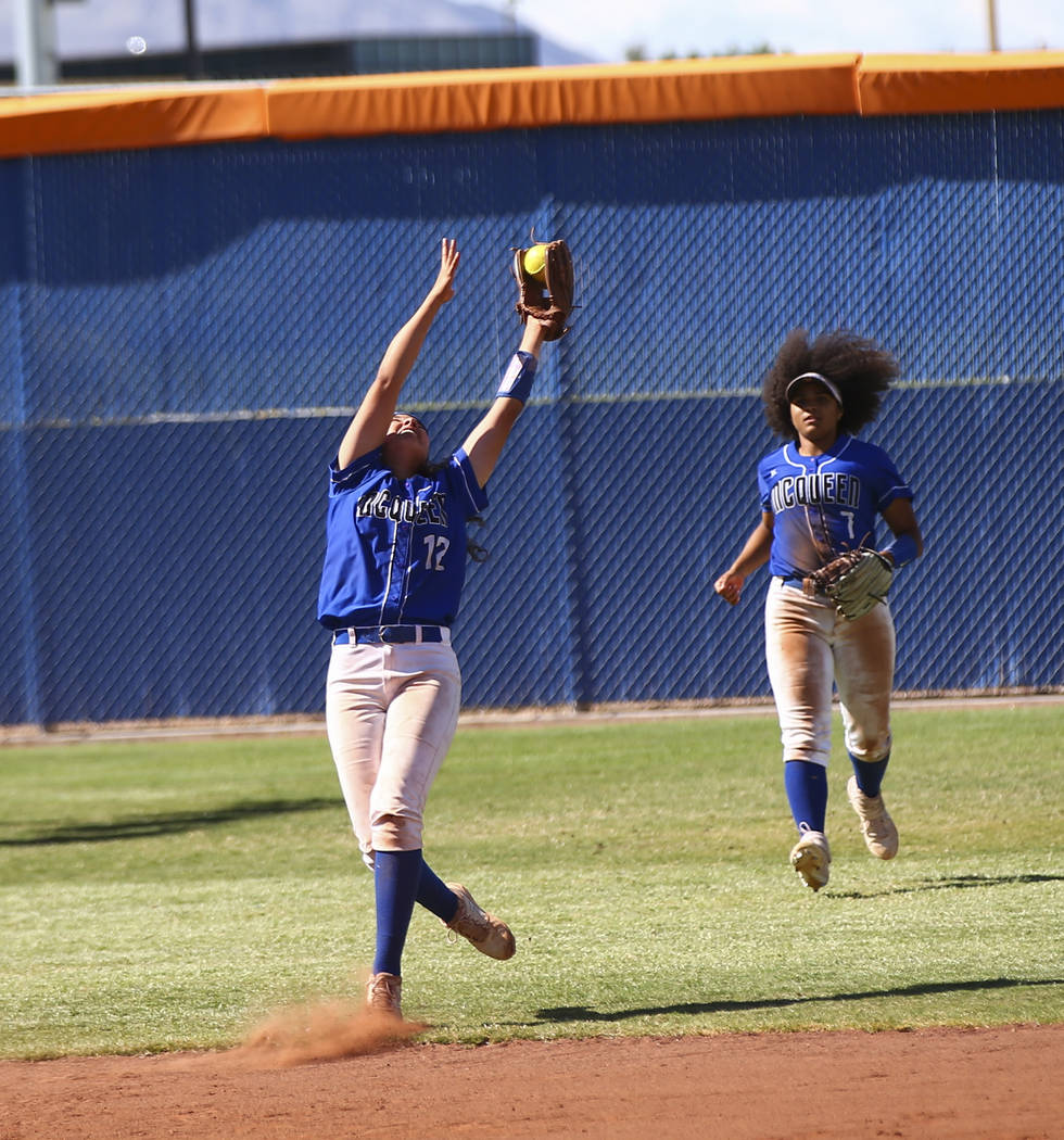 McQueen's Kiera Escalante (12) catches a fly ball from Shadow Ridge's Shea Clements, not pictur ...