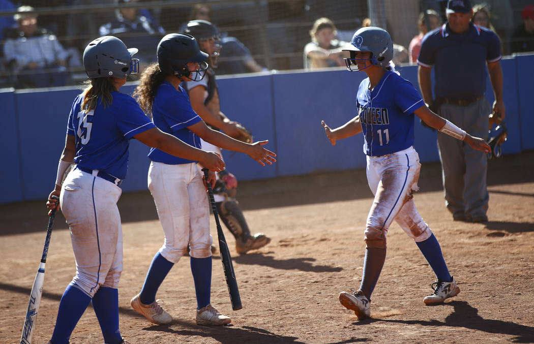 McQueen's Makayla Webber (11) celebrates her run with teammates while playing against Shadow Ri ...