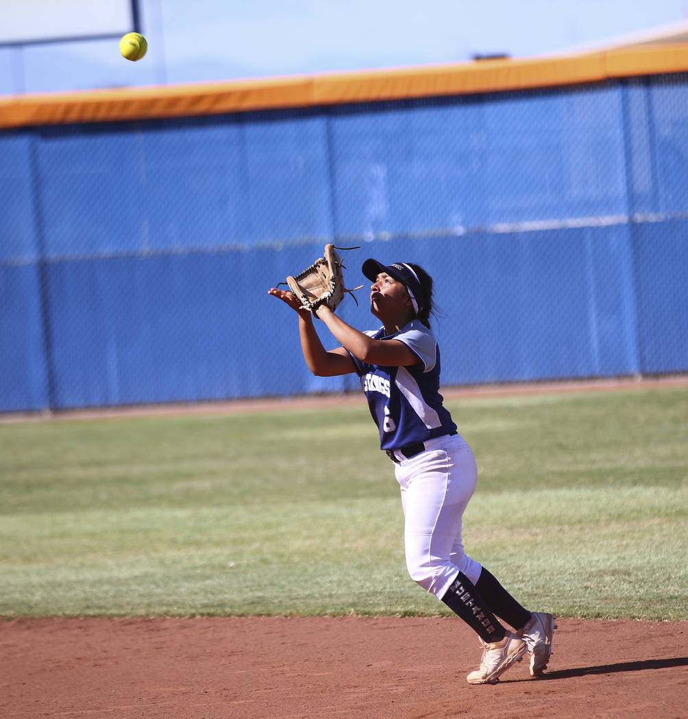 Shadow Ridge's Angelina Esqueda (6) catches a fly ball from McQueen's Kiera Escalante (12) duri ...