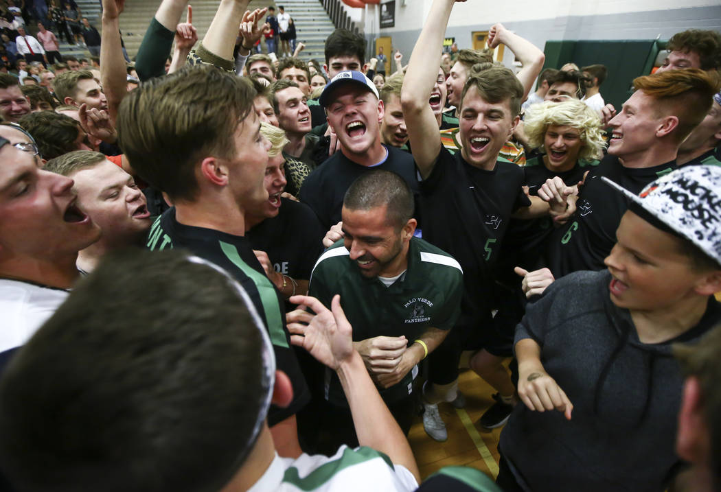 Palo Verde students and players celebrate their victory with head coach Phil Clarke, center, af ...