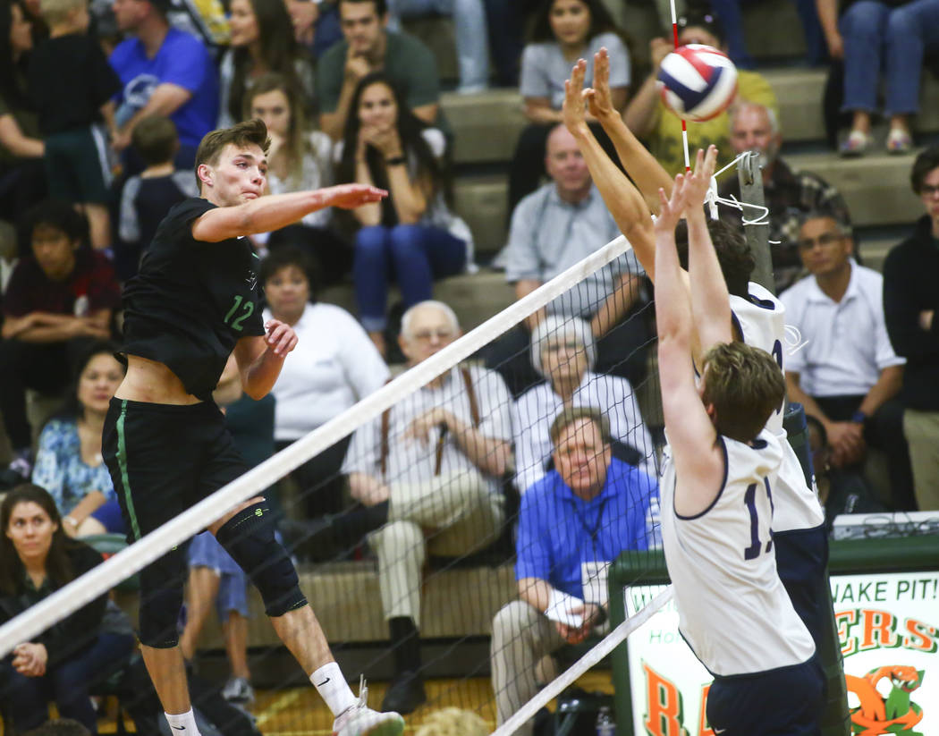 Palo Verde's Jared Brady (12) sends the ball past Coronado during the Class 4A state volleyball ...