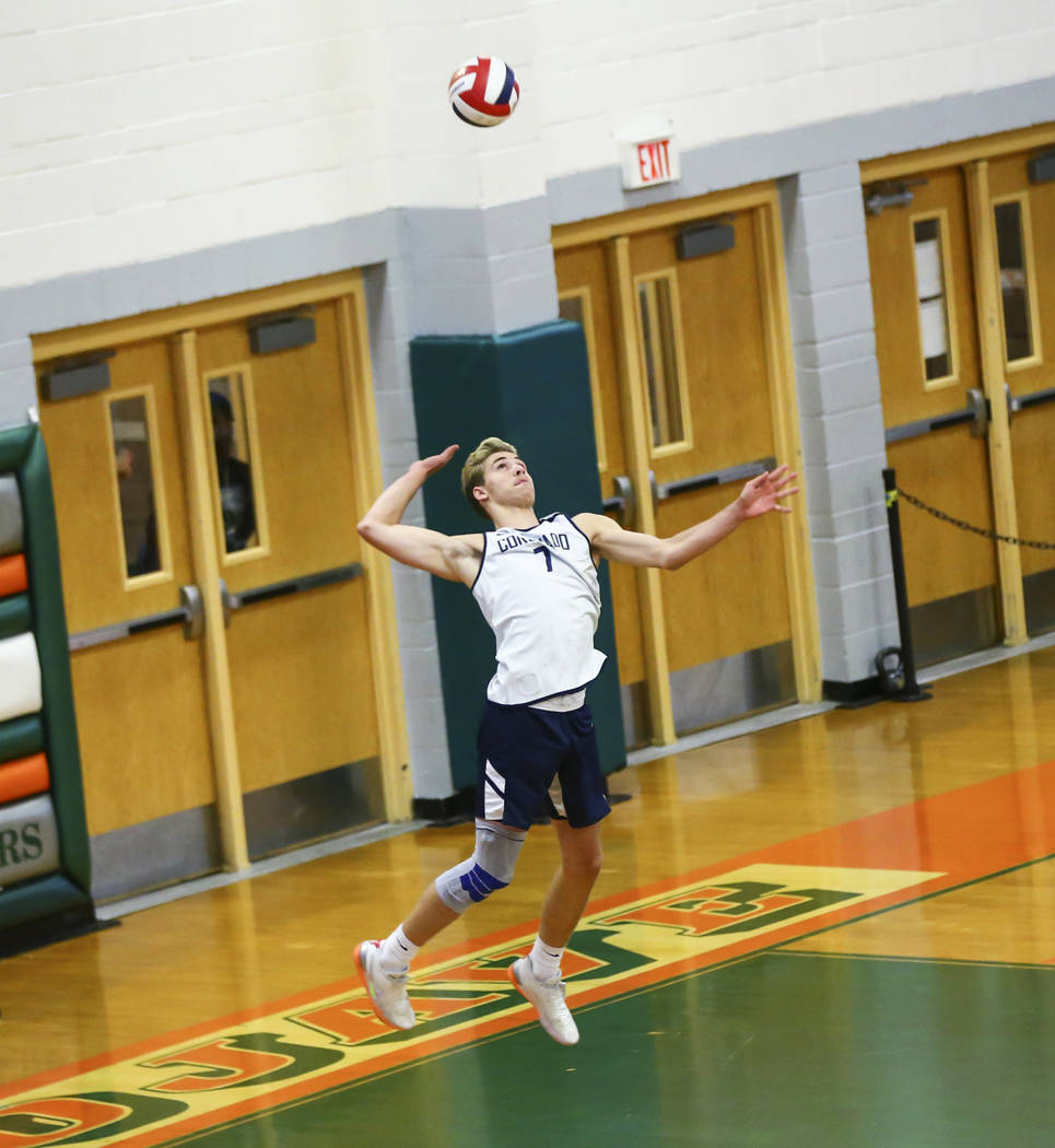 Coronado's Jacob Ceci (7) serves the ball to Palo Verde during the Class 4A state volleyball ch ...