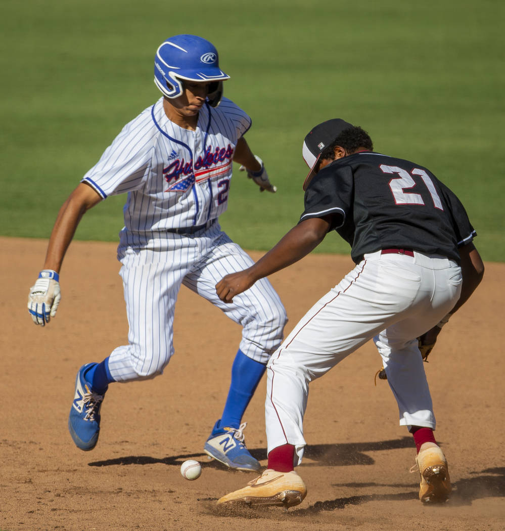 Reno's Skylar Hales (24) scurries safely back to first base after a bad throw to Desert Oasis' ...